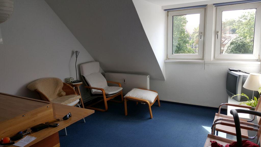 Wohnzimmer mit offener Küche – Löwen Immobilien Hildesheim